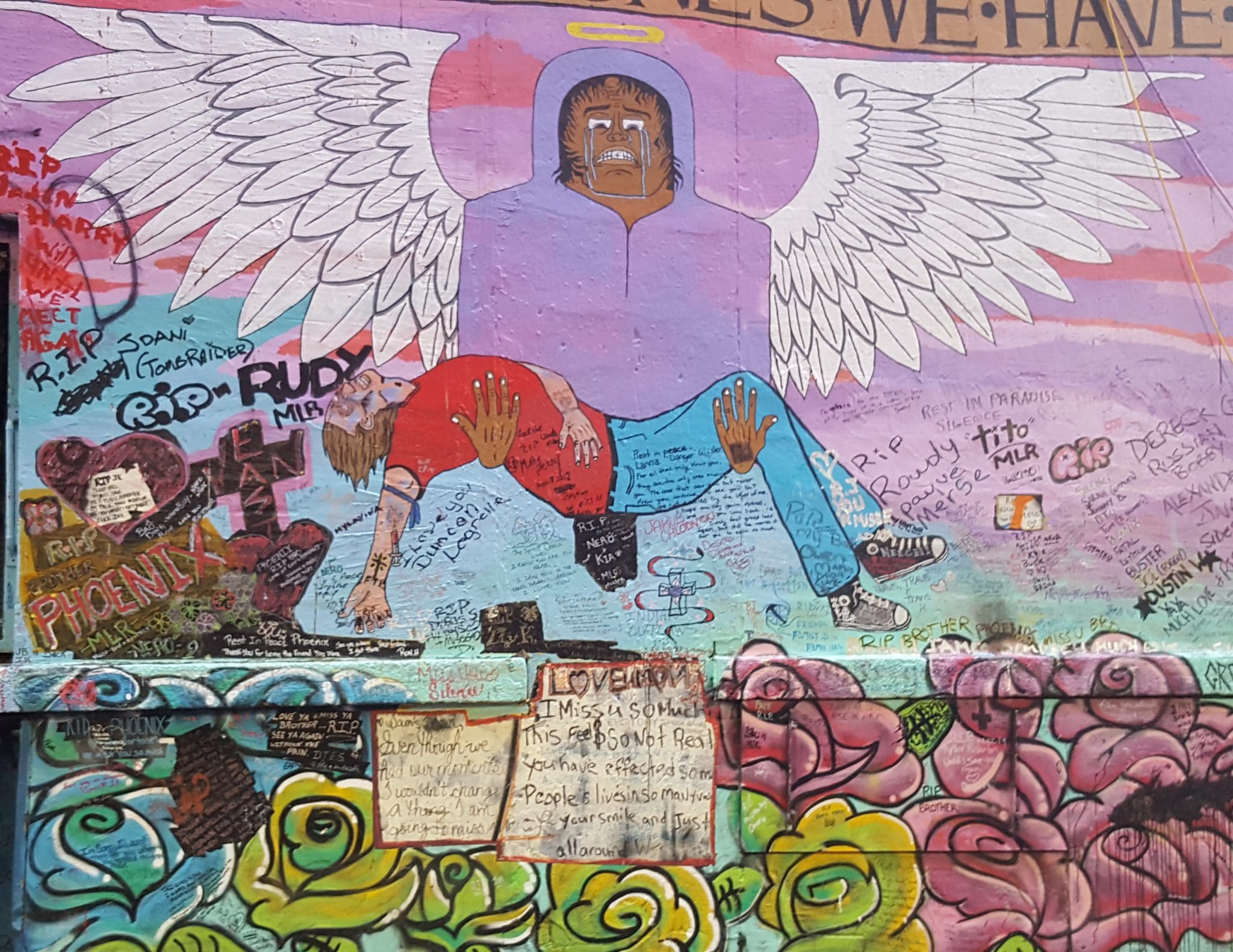 Graffiti mural of an angel lifting up somemone who is deceased | outcomes of prohibition
