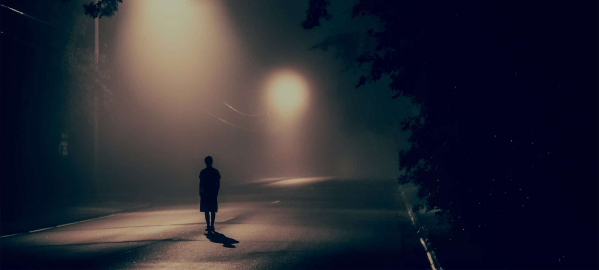 Man walking down lonely street