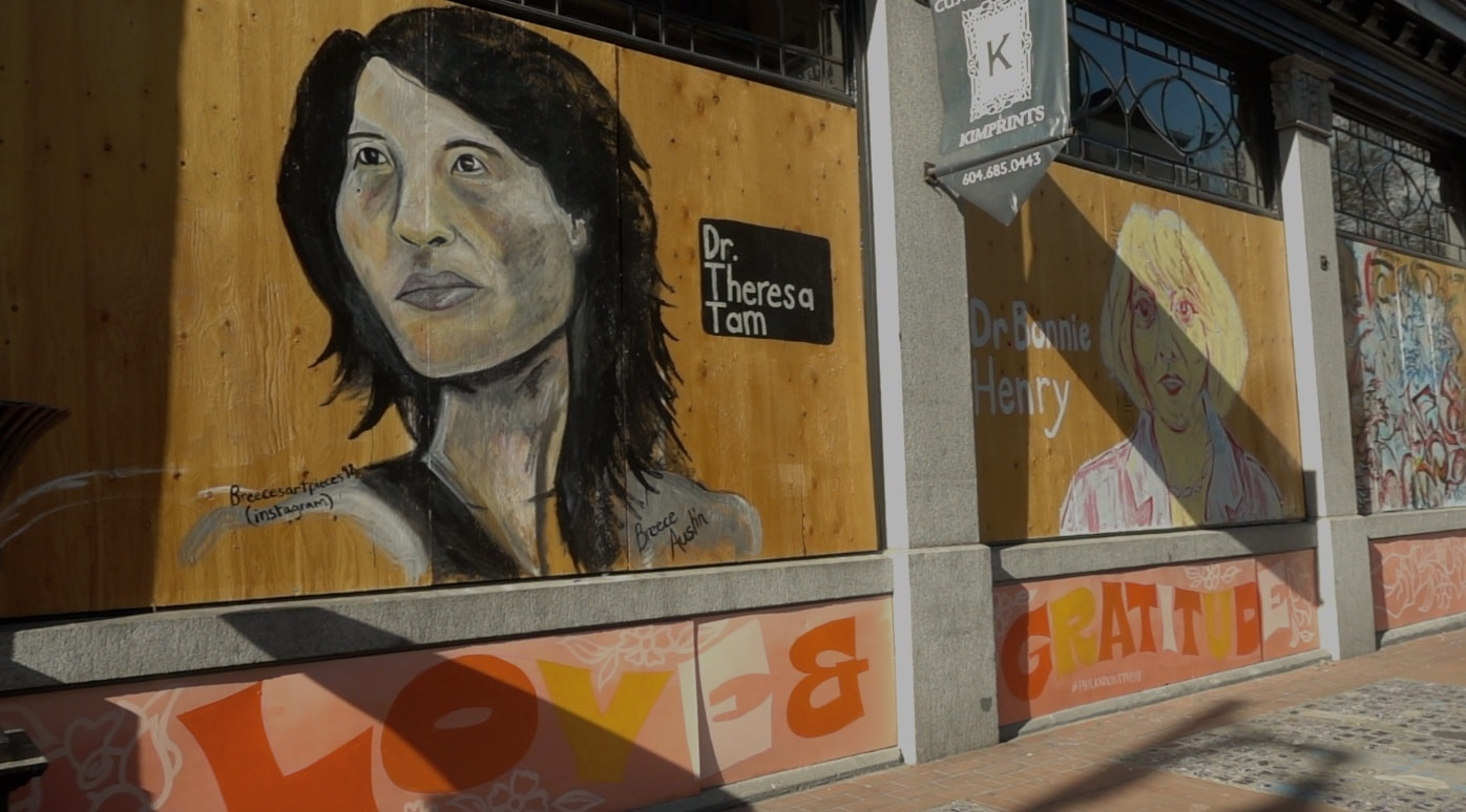 Theresa Tam and Bonnie Henry painted on two wooden murals in Gastown