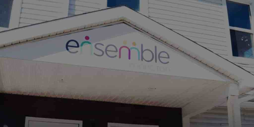Exterior of Ensemble Moncton's office, a white building with triangle roof