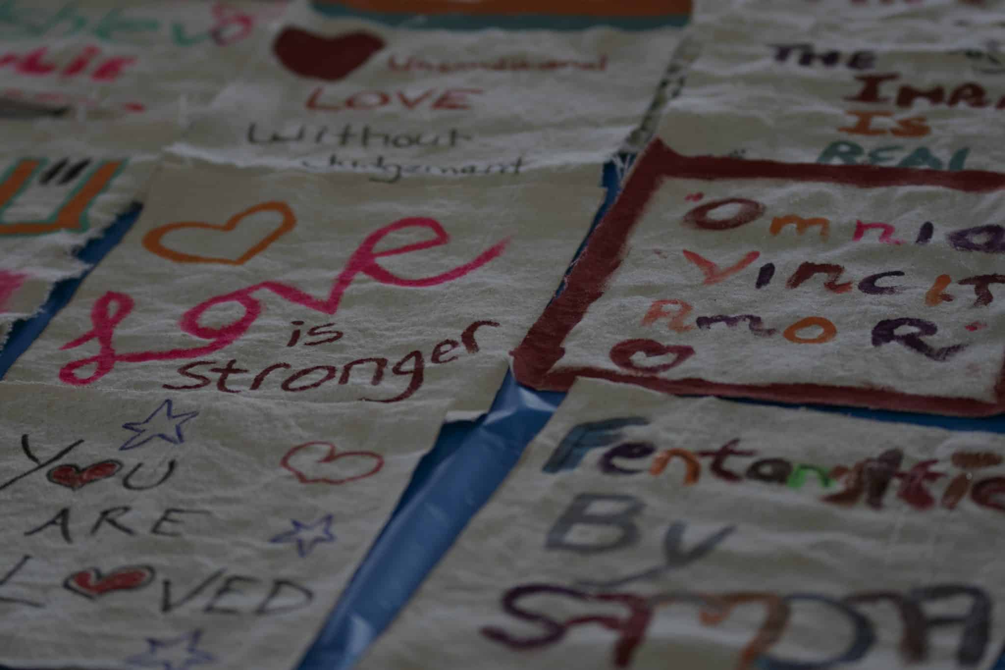 A quilted banner with wording stitched on it
