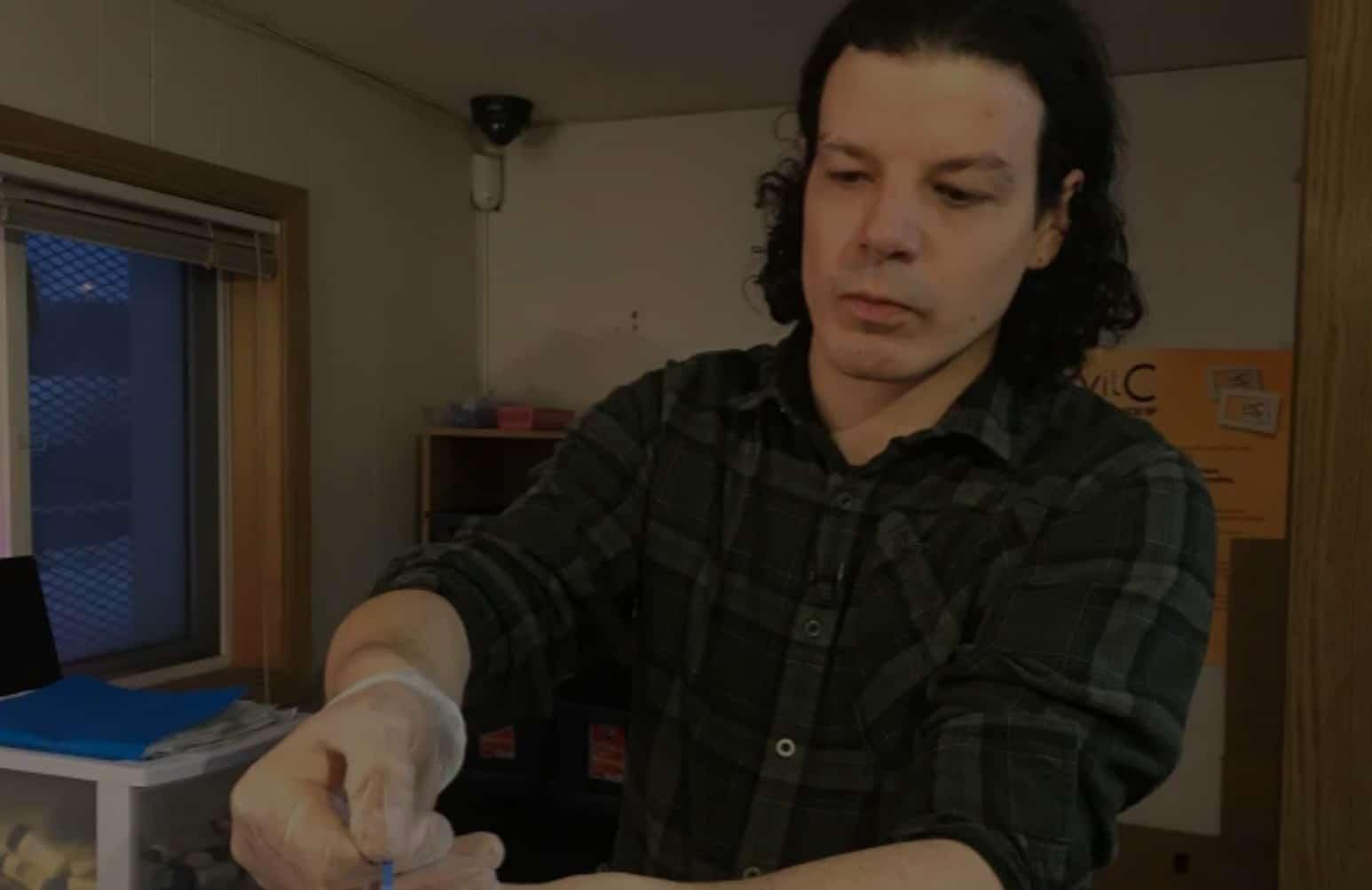 Harm reduction worker Jesse Whelan testing a sample of drugs