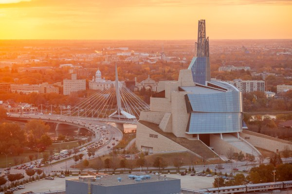 high angle shot of Manitoba buildings and bridge during a sunset