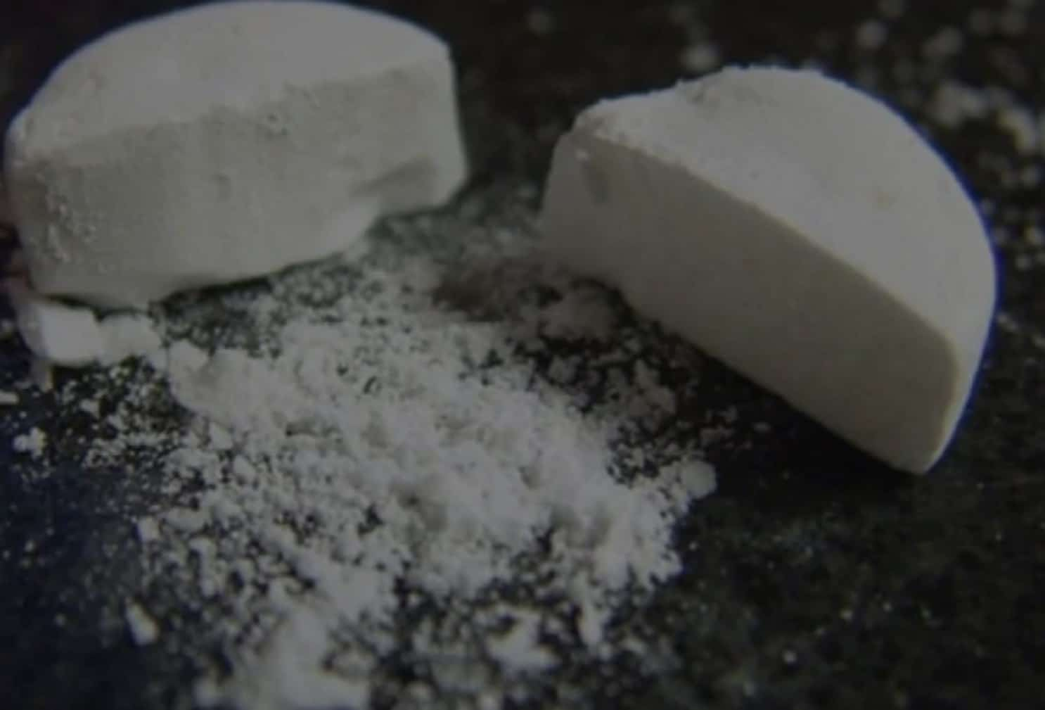 Crushed white pills on a table
