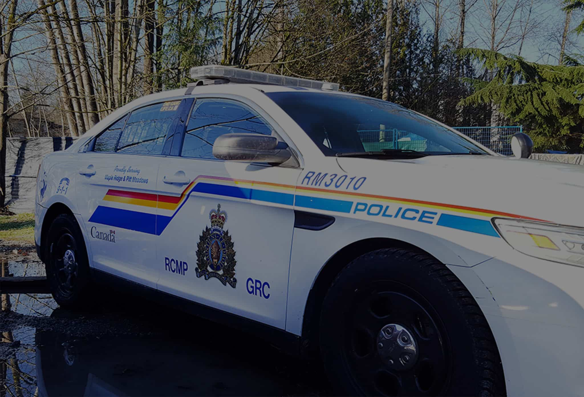 RCMP police cruiser outside of Anita Place tent city in Maple Ridge