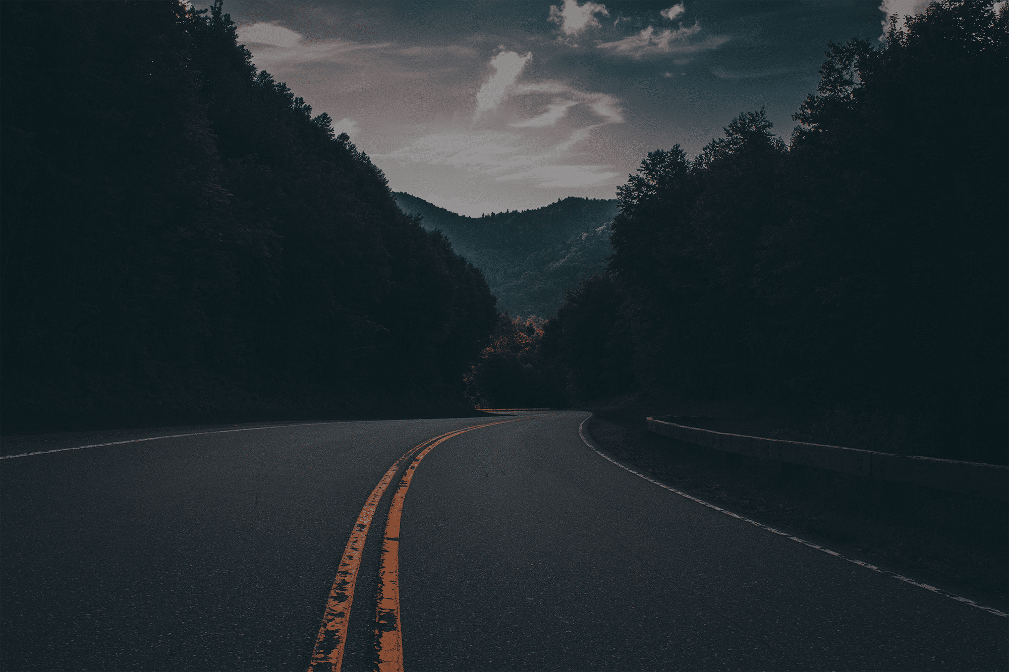 A winding highway towards mountains