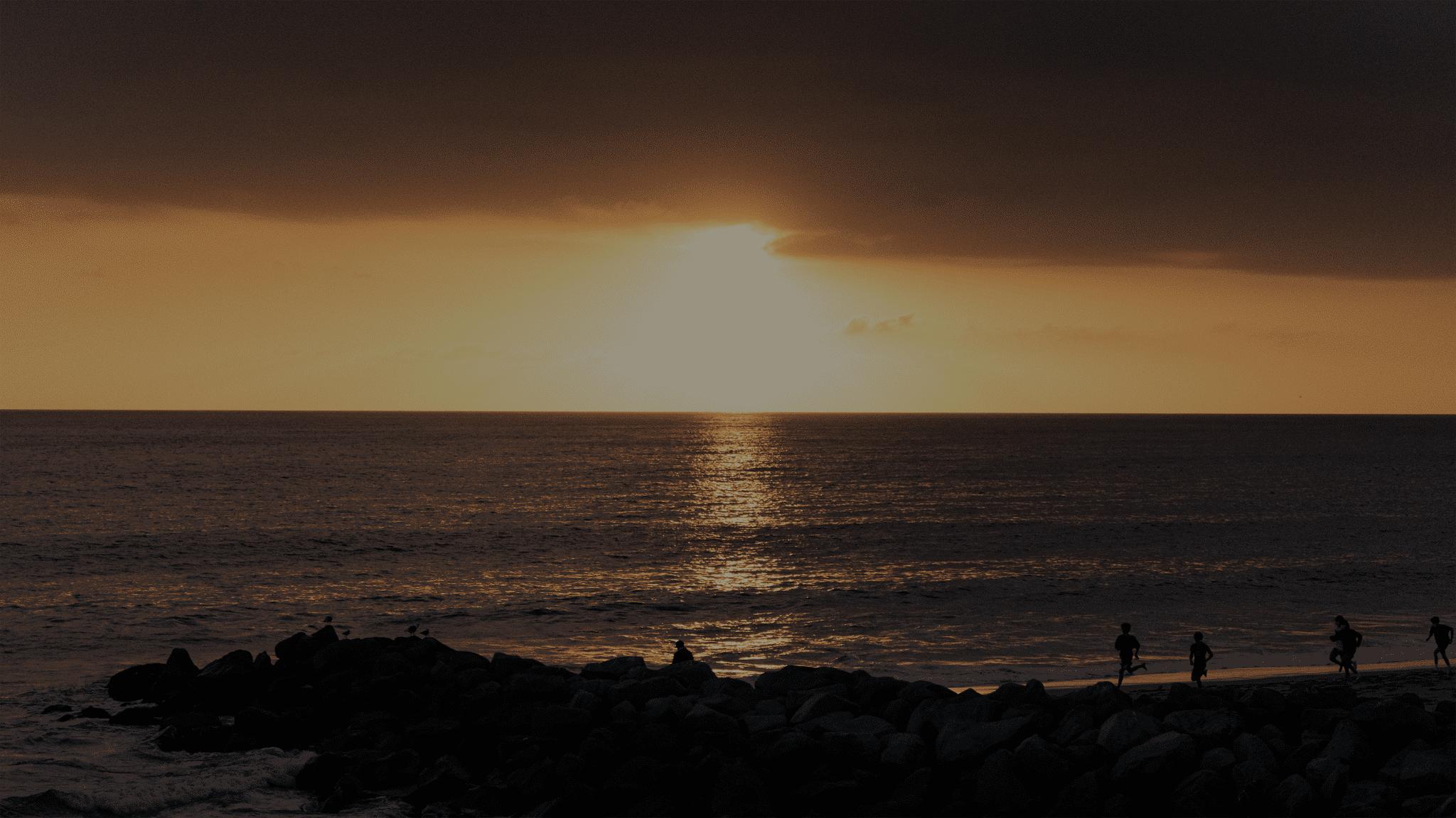 distant sunset from shorline