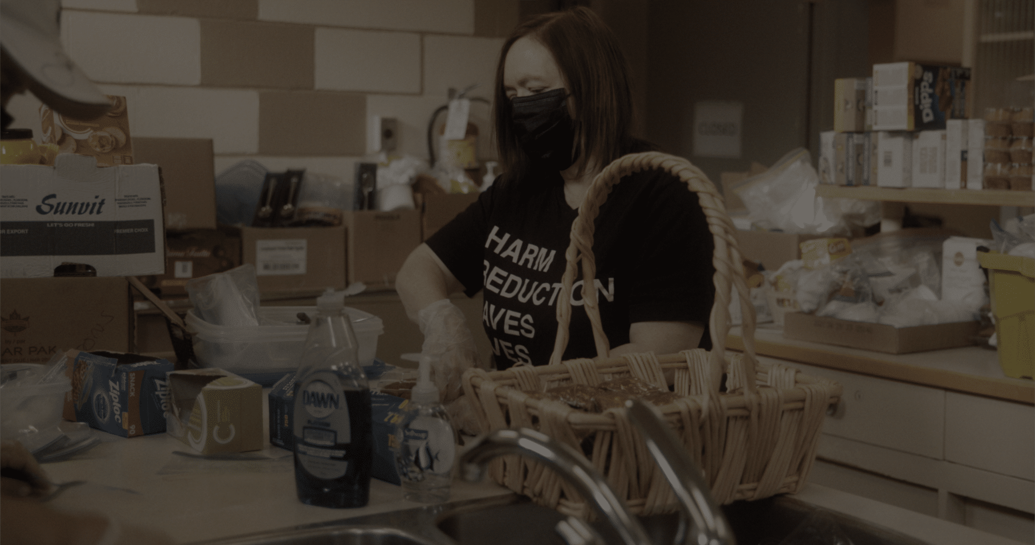 A woman packing food in a kitchen