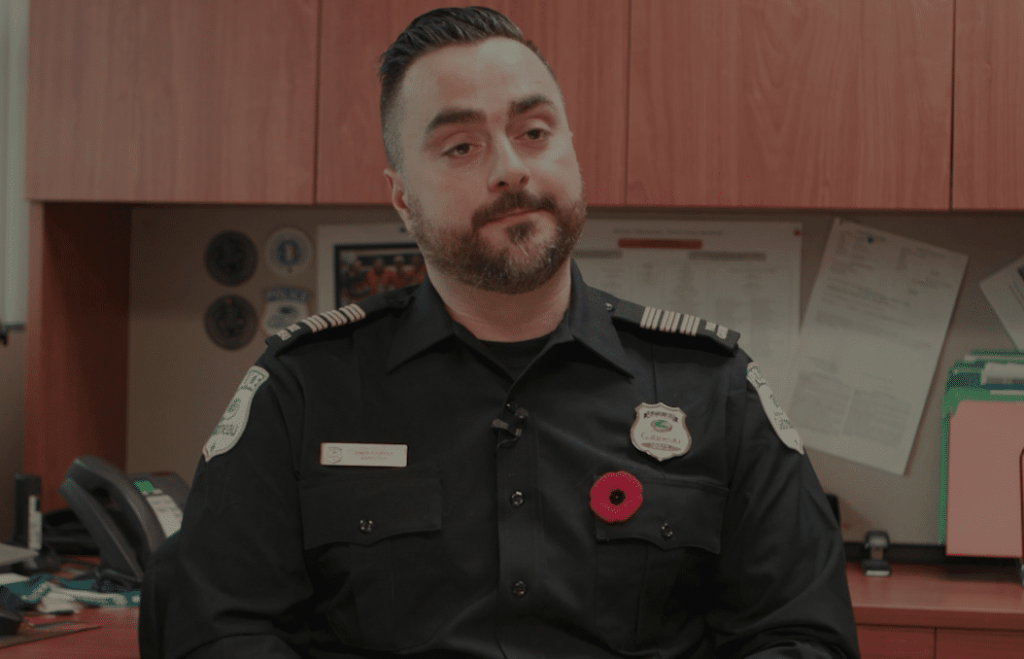 Police offer sitting at a desk, member of the Gatineau Police Service